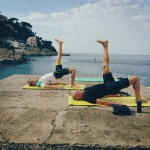 Crew pilates training on mats by the ocean in Antibes