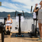 Crew working out on board a superyacht