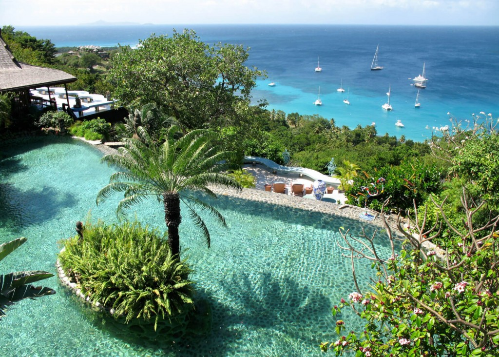 Mandalay estate Mustique infinity pool yachts palm trees