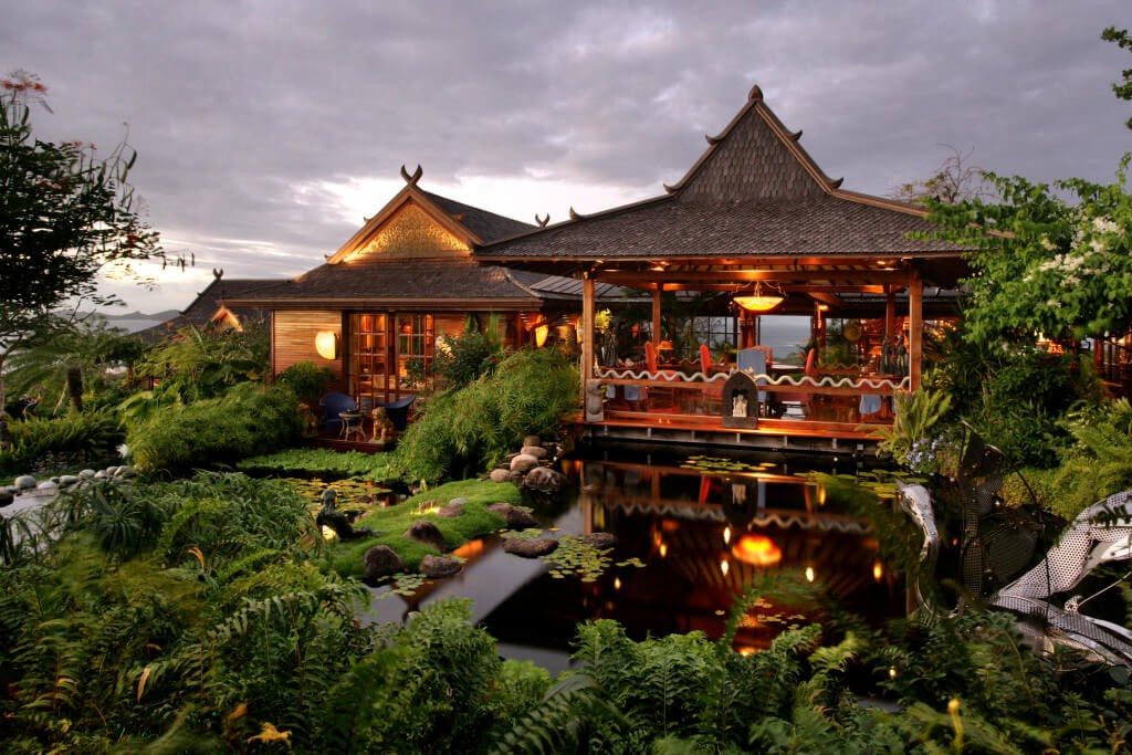 exterior Mandalay estate Mustique Balinese style koi pond