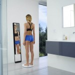 Lady looking in a Naked Mirror fitness scanner