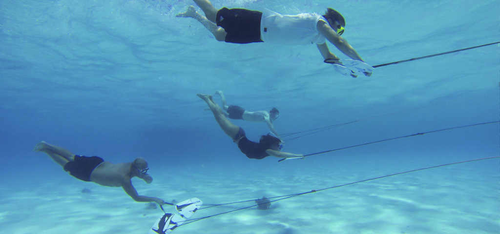 Four people underwater on Subwings