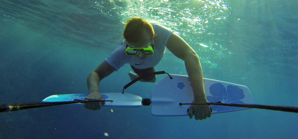 Man doing underwater roll on a Subwing