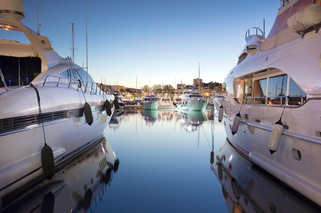View between two large yachts at Port Vauban, Antibes