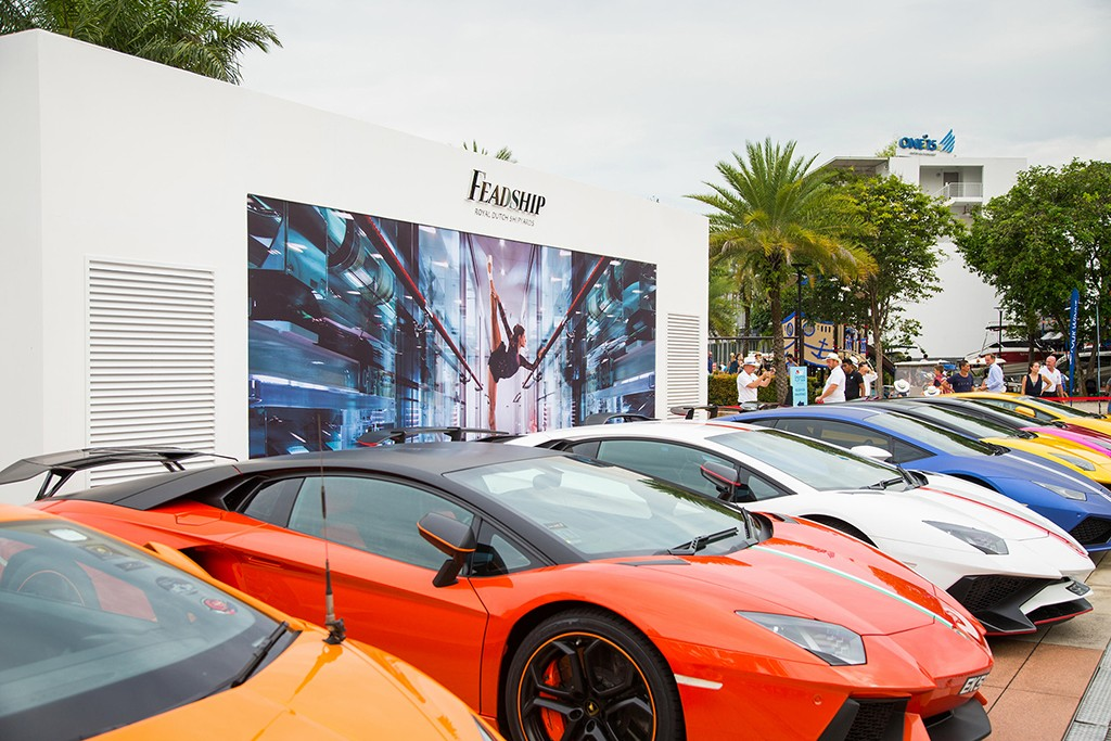 Supercars parked by Feadship booth at Singapre Yacht Show