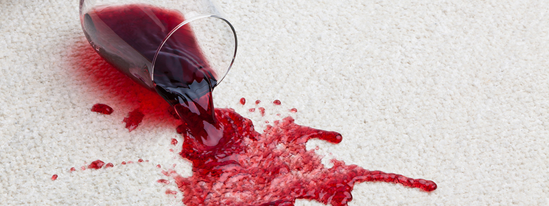Cream carpet with red wine spill