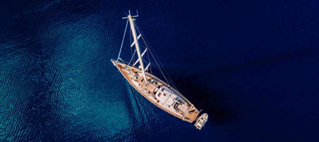A sailing yacht out at sea - birdseye view