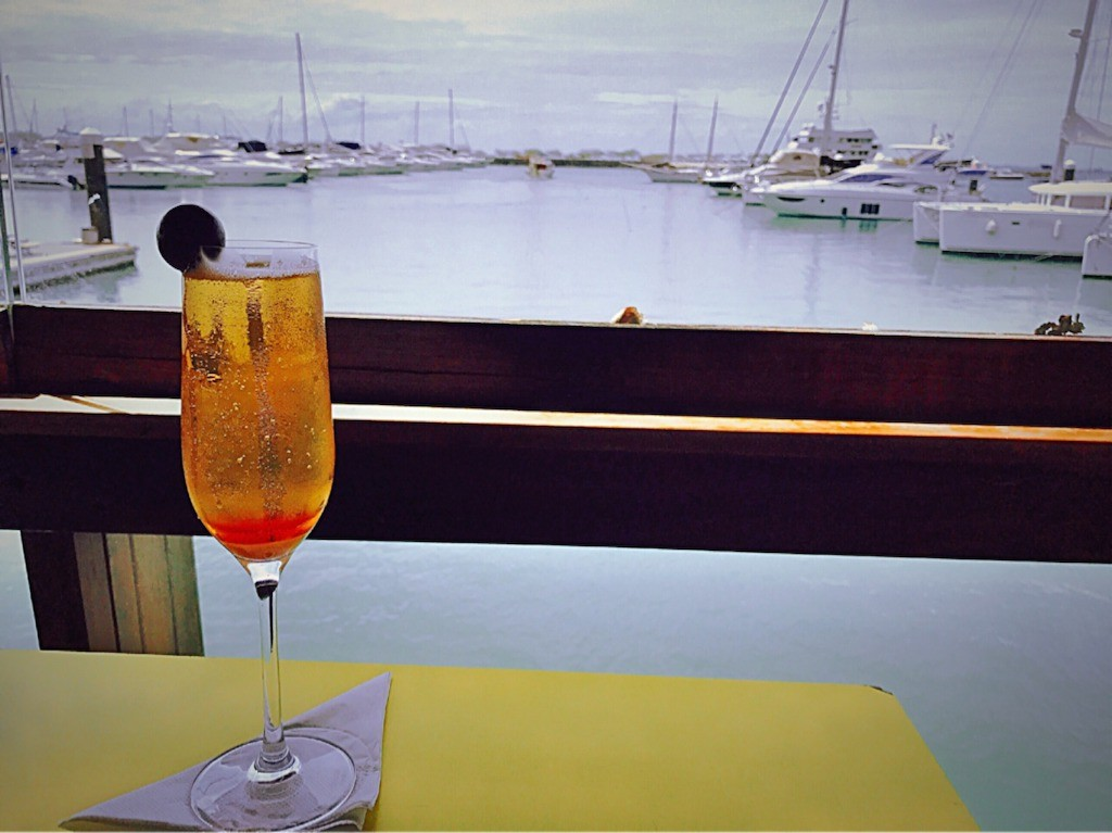 A cocktail and view of a marina