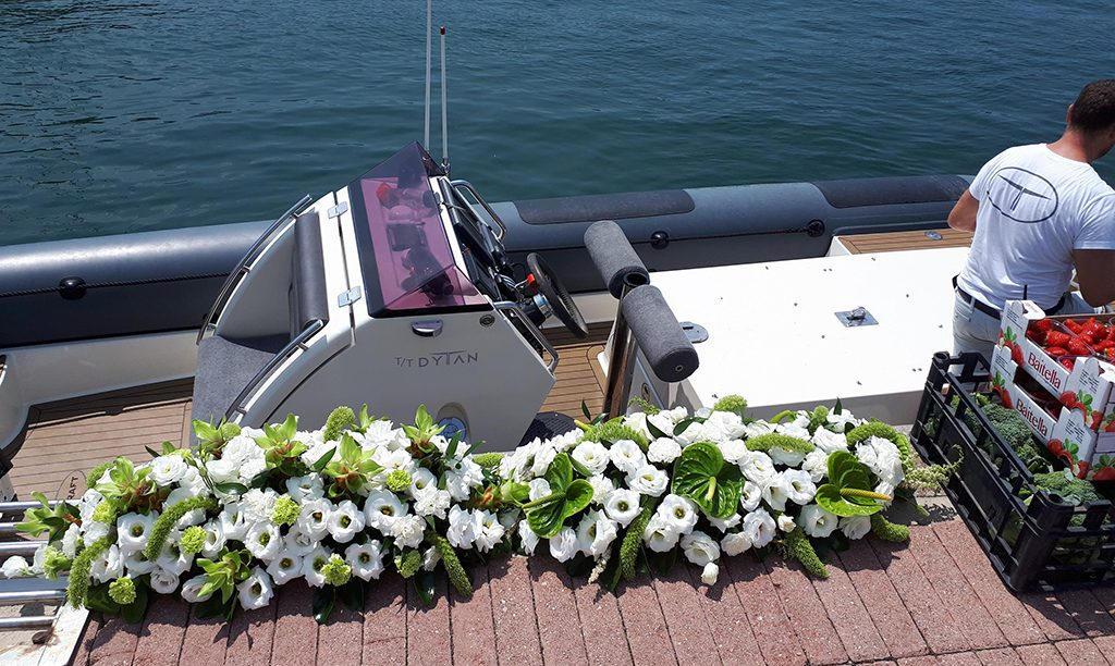 Superyacht tender carrying flowers to the yacht