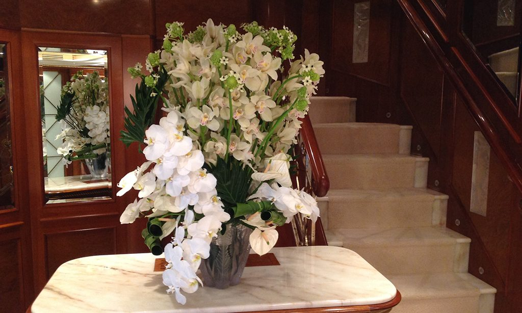 Floral display on superyacht staircase